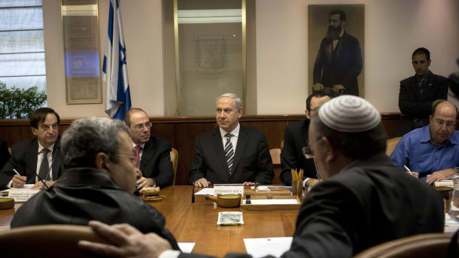Israeli Prime Minister Benjamin Netanyahu, center, together with Vice Prime Minister Silvan Shalom, second left, Deputy Prime Minister Dan Meridor, left, Cabinet Minister Moshe Yaalon, right, Israeli Defense Minister Ehud Barak, front row left, and Minister of Science and Technology Daniel Hershkowitz, attend the weekly cabinet Jerusalem, Sunday, Nov. 11, 2012. Netanyahu says his country is ready to strike harder against Gaza Strip militants if they don't stop attacking Israel. (AP Photo/Sebastian Scheiner, Pool)