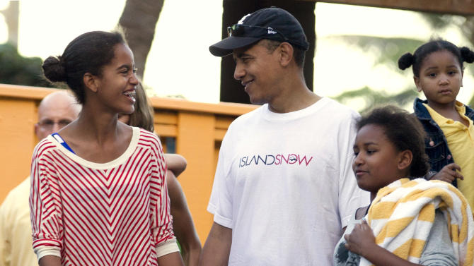 FILE - In this Dec. 27, 2011, file photo President Barack Obama holds hands with his daughters Malia, left, and Sasha, right, as they leave Sea Life Park, a marine wildlife park, with family friends in Waimanalo, Hawaii. Obama likes to talk about his kids. What parent doesn't? But he's the president, and he brings up his daughters to explain his thinking on all sorts of combustible national issues, from the rescue of an American aid worker from Somali pirates to the touchy subject of public access to emergency contraception. (AP Photo/Carolyn Kaster, File)