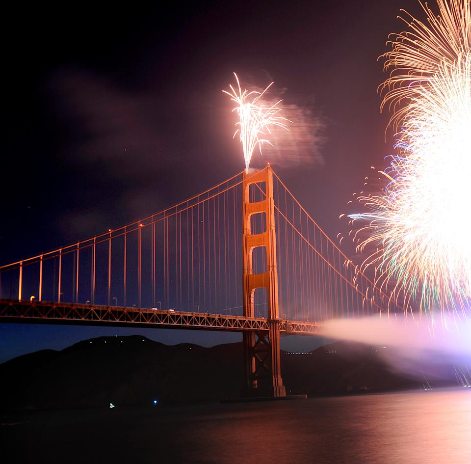 Fireworks burst over the Golden Gate Bridge as part of the span's 75th anniversary celebration on Sunday, May 27, 2012, in San Francisco. (AP Photo/Noah Berger)