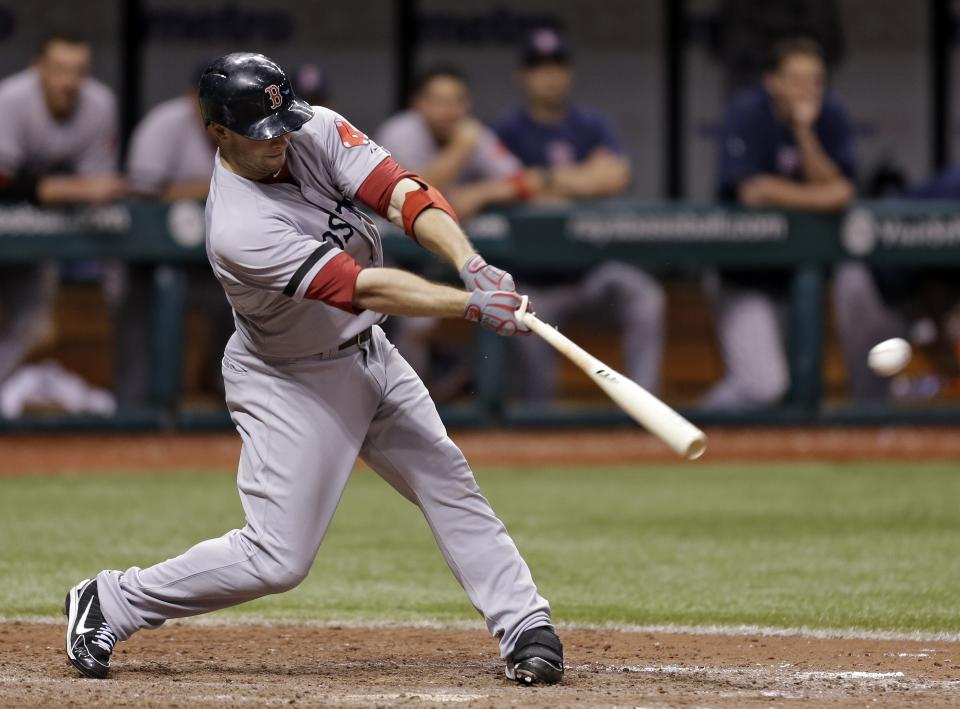 Boston Red Sox's Daniel Nava lines a 14th inning RBI single off Tampa Bay Rays relief pitcher Cesar Ramos during a baseball game Tuesday, June 11, 2013, in St. Petersburg, Fla. Boston's Shane Victorino scored. (AP Photo/Chris O'Meara)