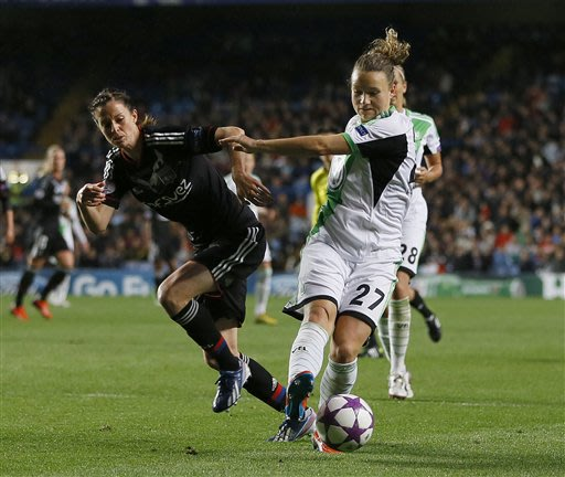 Wolfsburg's Josephine Henning, right, vies for the ball with Lyon's Lotta Schelin during the Women's Champions League final soccer match between Wolfsburg and Olympique Lyonnais at Stamford Bridge Sta