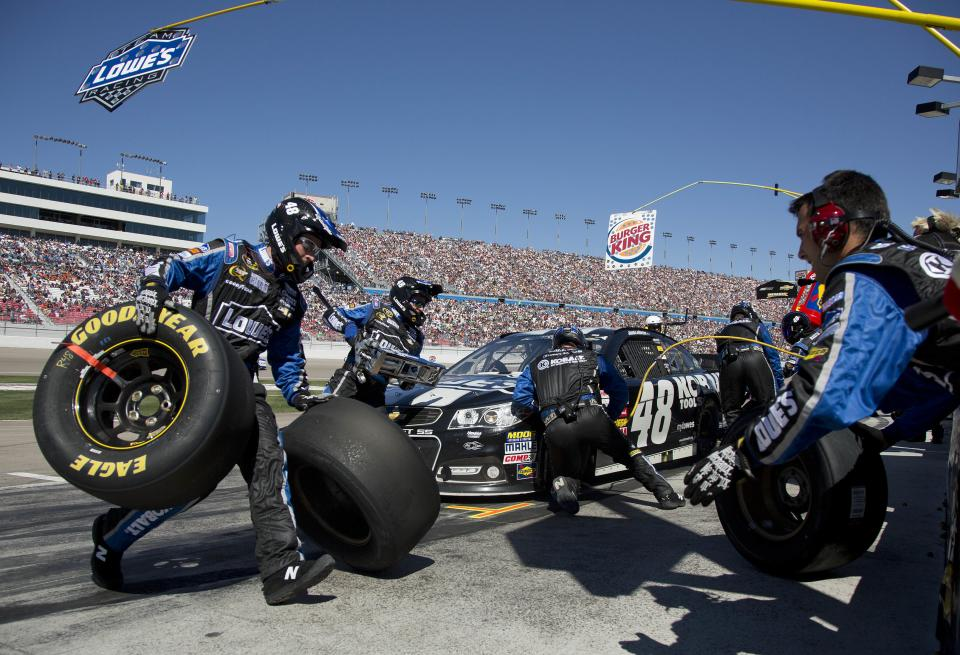 Jimmie Johnson crew works on his car during a pit stop in the NASCAR Sprint Cup Series auto race, Sunday, March 10, 2013 in Las Vegas. (AP Photo/Julie Jacobson)