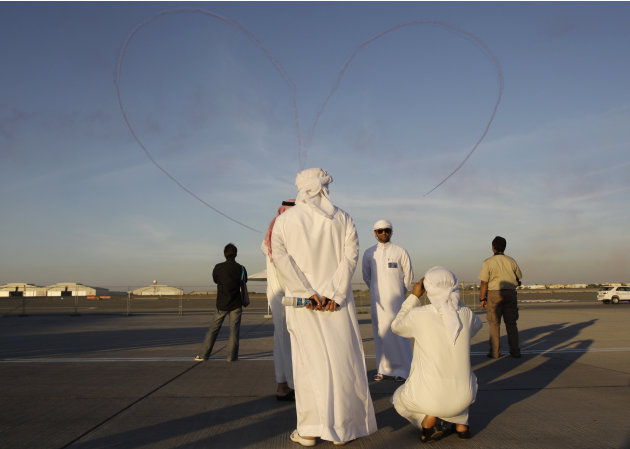 An Emirati man takes photos …