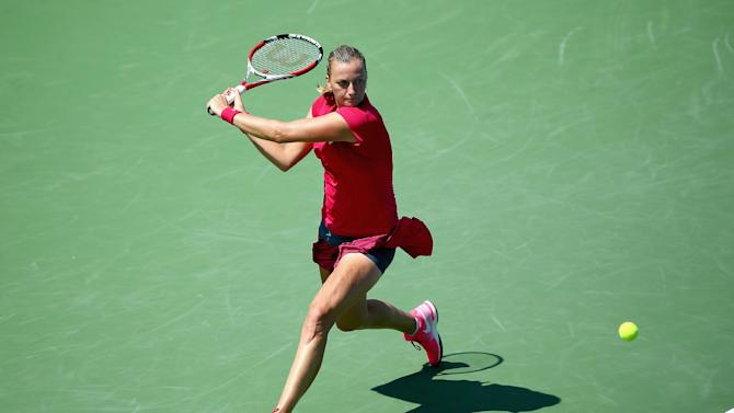 Petra Kvitova of the Czech Republic hits a return during her match against Elina Svitloina of the Ukraine on August 13, 2014 at the Linder Family Tennis Center in Cincinnati, Ohio
