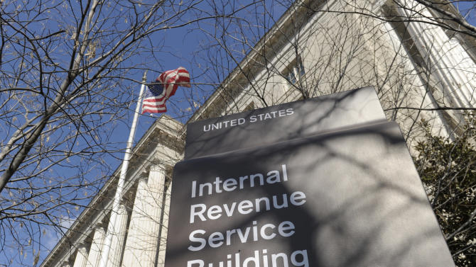 FILE - This March 22, 2013, file photo, shows the exterior of the Internal Revenue Service building in Washington. The Internal Revenue Service has recouped more than $5.5 billion under a series of programs that offered reduced penalties and no jail time to people who voluntarily disclosed assets they were hiding overseas, government investigators said Friday, April 26, 2013. In all, more than 39,000 tax cheats have come clean under the programs.(AP Photo/Susan Walsh, File)