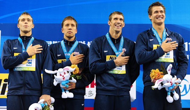 (L-R) US gold medalists Nicholas Thoman, Mark Gangloff, Michael Phelps and Nathan Adrian listen to their national anthem on the podium during the award ceremony for the final of the men's 4x100 medley