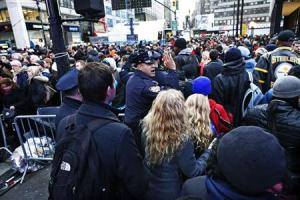 A New York Police officer tries to control the massive traffic of fans at Super Bowl Boulevard zone in New York