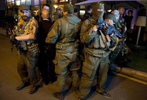 Armed men protect the pro-Russian self-proclaimed Prime…