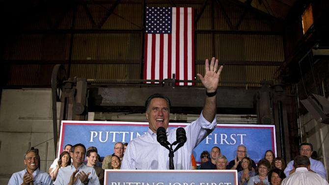 Republican presidential candidate, former Massachusetts Gov. Mitt Romney waves as he arrives to for campaign stop at Weatherly Casting Company in Weatherly, Pa., Saturday, June 16, 2012.  (AP Photo/Evan Vucci)