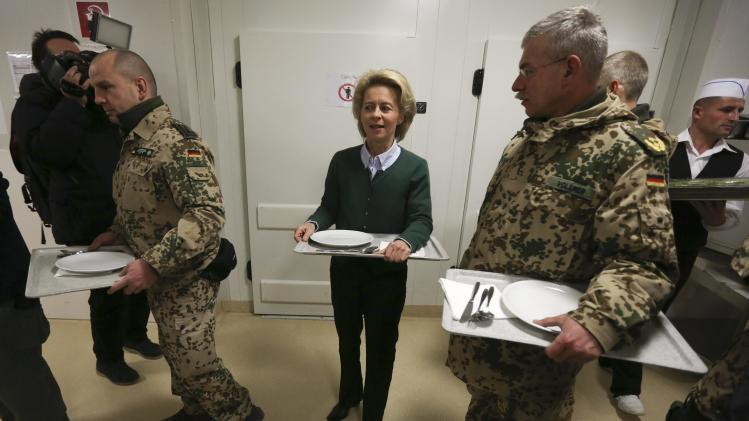 German Defence Minister Ursula von der Leyen stands in line with German troops for breakfast in Mazar-i-Sharif