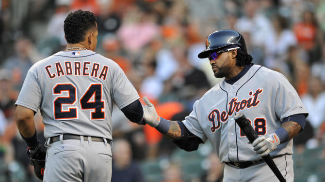 Detroit Tigers' Prince Fielder, right, congratulates teammate Miguel Cabrera who hit a two-run home run against the Baltimore Orioles in the first inning of a baseball game on Friday, May 31, 2013, in Baltimore. (AP Photo/Gail Burton)