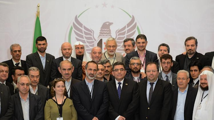 Ghassan Hitto, the Syrian opposition's newly elected interim prime minister, center right, and head of the Syrian National Coalition for Opposition and Revolutionary Forces Mouaz al-Khatib, center left, and other members seen during a meeting in Istanbul, Turkey, Tuesday, March 19, 2013. Hitto has ruled out dialogue with President Bashar Assad's regime. .(AP Photo)