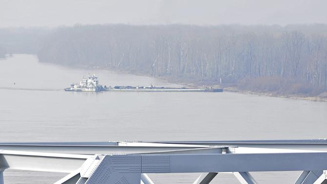Barge hits Miss. River bridge; oil cleanup ongoing