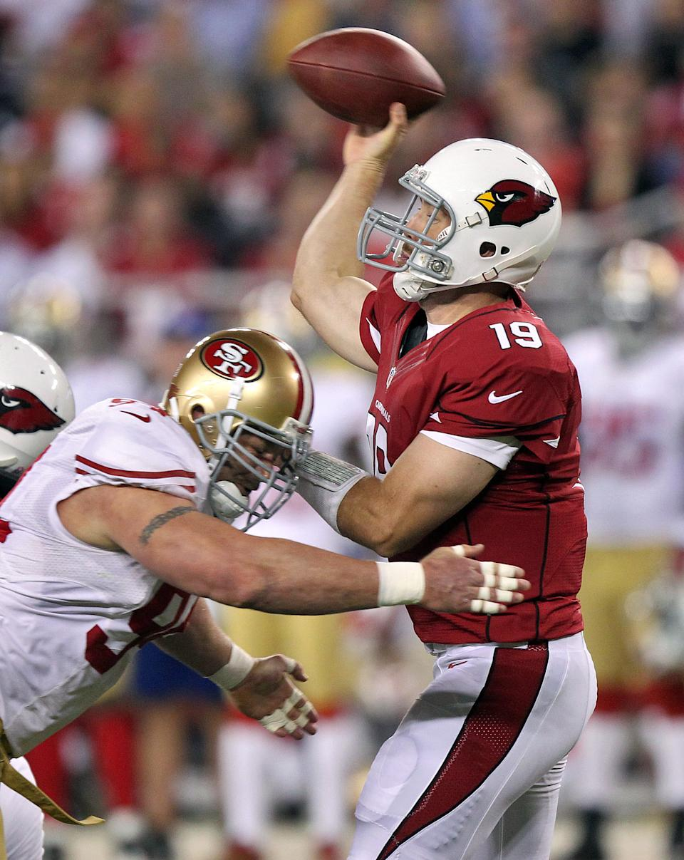 Arizona Cardinals quarterback John Skelton (19) looks to pass under pressure from San Francisco 49ers defensive end Justin Smith during the first half of an NFL football game, Monday, Oct. 29, 2012, in Glendale, Ariz.  (AP Photo/Paul Connors)