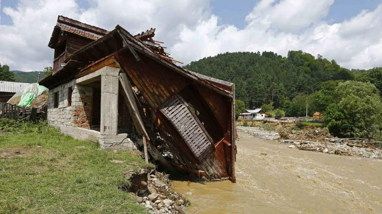A destroyed house is seen after flash floods in Vaideeni