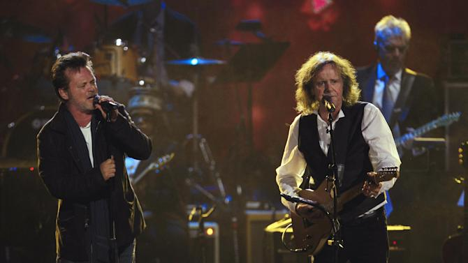 John Mellencamp, left, and Donovan Leitch perform after Donovan's induction into the Rock and Roll Hall of Fame Saturday, April 14, 2012, in Cleveland. (AP Photo/Tony Dejak)