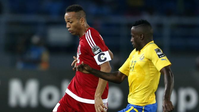 Emilio Nsue Lopez of Equatorial Guinea fights for the ball with Gabon's Andre Biyogho Poko during their Group A soccer match at the African Cup of Nations in Bata