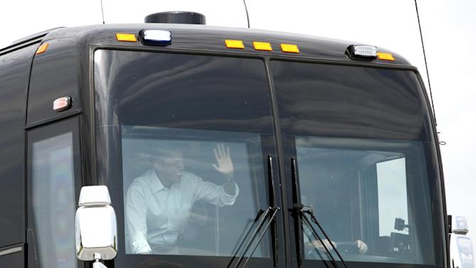 FILE - In this Aug. 17, 2011 file photo, President Barack Obama waves out of his bus as he leaves a town hall meeting in Atkinson, Illinois. President Barack Obama is embarking on his first bus tour of the 2012 campaign, seeking to raise more questions about rival Mitt Romney's business record. At the same time, the president will face another important update on the economy.  (AP Photo/Charlie Neibergall, File)