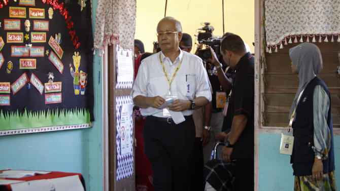 Malaysian Prime Minister Najib Razak arrives to cast his ballot in the general elections at a polling station in Pekan, Pahang state, Malaysia, Sunday, May 5, 2013. Malaysians have begun voting in emotionally charged national elections that could see the long-ruling coalition ousted after nearly 56 years in power. (AP Photo/Lai Seng Sin)