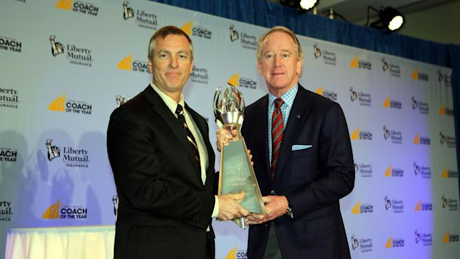 IMAGE DISTRIBUTED FOR LIBERTY MUTUAL INSURANCE - 2012 Liberty Mutual Coach of the Year Award winner Willie Fritz, Sam Houston State, poses for photos with Archie Manning (R) at the 2012 Liberty Mutual Coach of the Year Award Winners Announcement, on Monday, Jan. 7, 2013 in Ft. Lauderdale, Fla. (Photo by Marc Serota/Invision for Liberty Mutual Insurance/AP Images)