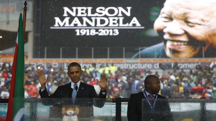 U.S. President Barack Obama addresses the crowd during a memorial service for Nelson Mandela at FNB Stadium in Johannesburg