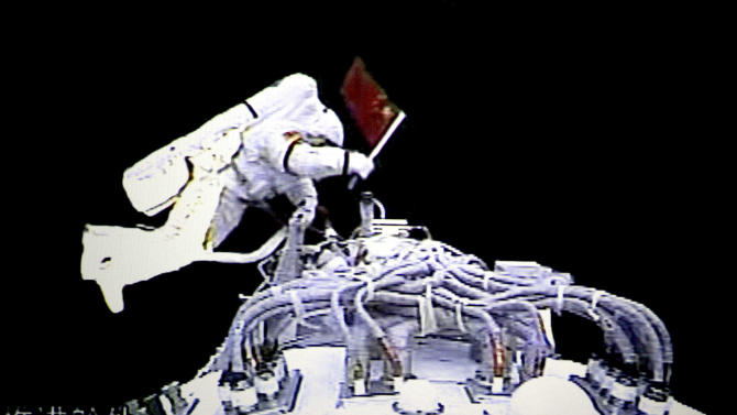FILE - In this video grab taken at the Beijing Space Command and Control Center released by China's Xinhua News Agency, Saturday, Sept. 27, 2008, Chinese astronaut Zhai Zhigang walks outside the orbit module of the Shenzhou-7 spacecraft for a spacewalk. China's astronauts have braved the tension of docking with a space station and performed delicate tasks outside their orbiting capsule, but now face a more down-to-Earth job that is perhaps equally challenging: Talking to young people about science. Coming on the heels of Canadian astronaut Chris Hadfield's wildly popular YouTube videos from the International Space Station, the three astronauts aboard China's latest mission, expected to launch early June 2013, plan to deliver a series of talks to students from aboard China's Tiangong 1 space lab. (AP Photo/Beijing Space Command and Control Center via Xinhua, File)