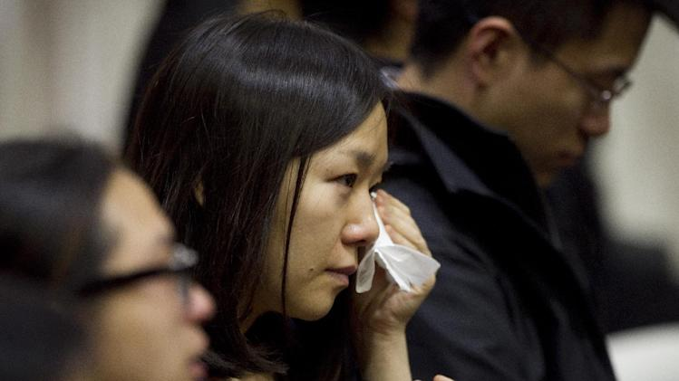 A member of the audience sheds tears during Lu Lingzi's eulogy, delivered by her father, Lu June at Metcalf Hall in Boston University's George Sherman Student Union on Monday, April 22, 2013. Lingzi was killed in the Boston Marathon bombings. (AP Photo/The Boston Globe, Dina Rudick, Pool)
