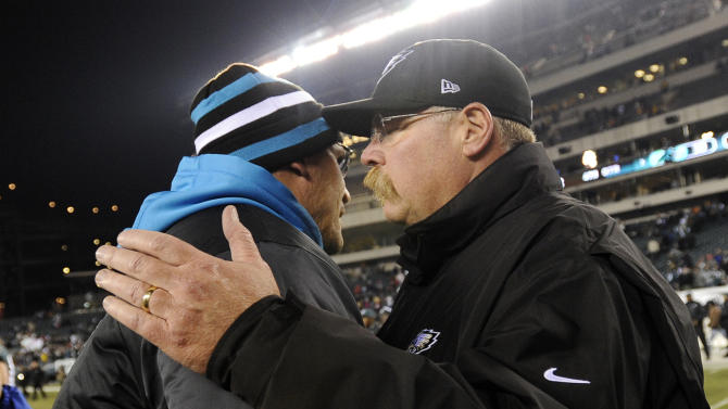 Philadelphia Eagles head coach Andy Reid, right, greets Carolina Panthers head coach Ron Rivera after an NFL football game, Monday, Nov. 26, 2012, in Philadelphia. Carolina won 30-22. (AP Photo/Michael Perez)