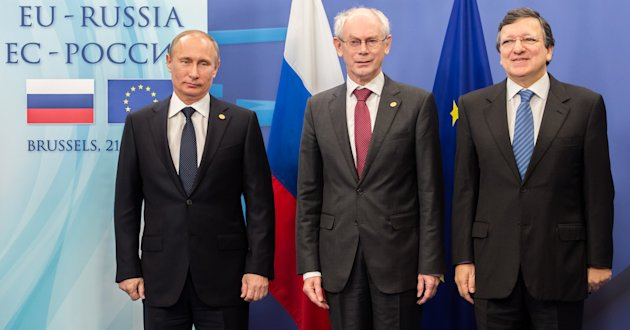 Russia's President Vladimir Putin, left, poses for photographers with European Council President Herman Van Rompuy, center, and European Commission President Jose Manuel Barroso during the EU-Russia summit, at the European Council building in Brussels, Friday, Dec. 21, 2012. (AP Photo/Geert Vanden Wijngaert)