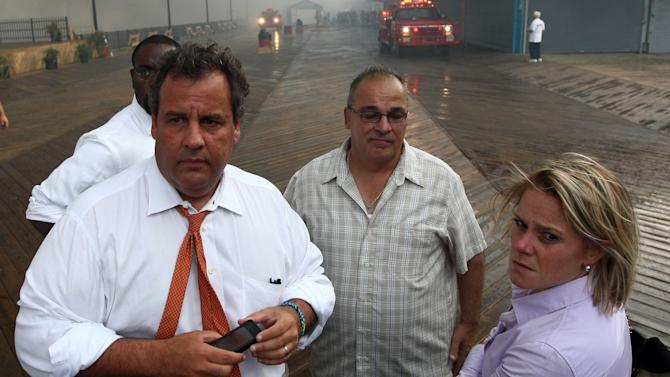 """In this Sept. 12, 2013 photo provided by the Office of the Governor of New Jersey, Deputy Chief of Staff Bridget Anne Kelly, right, stands with Gov. Chris Christie, left, during a tour of the Seaside Heights, N.J. boardwalk after it was hit by a massive fire. Christie fired Kelly Thursday, Jan. 9, 2014, and apologized over and over for his staff's """"stupid"""" behavior, insisting during a nearly two-hour news conference that he had no idea anyone around him had engineered traffic jams as part of a political vendetta against a Democratic mayor. (AP Photo/Office of Gov. Chris Christie, Tim Larsen)"""