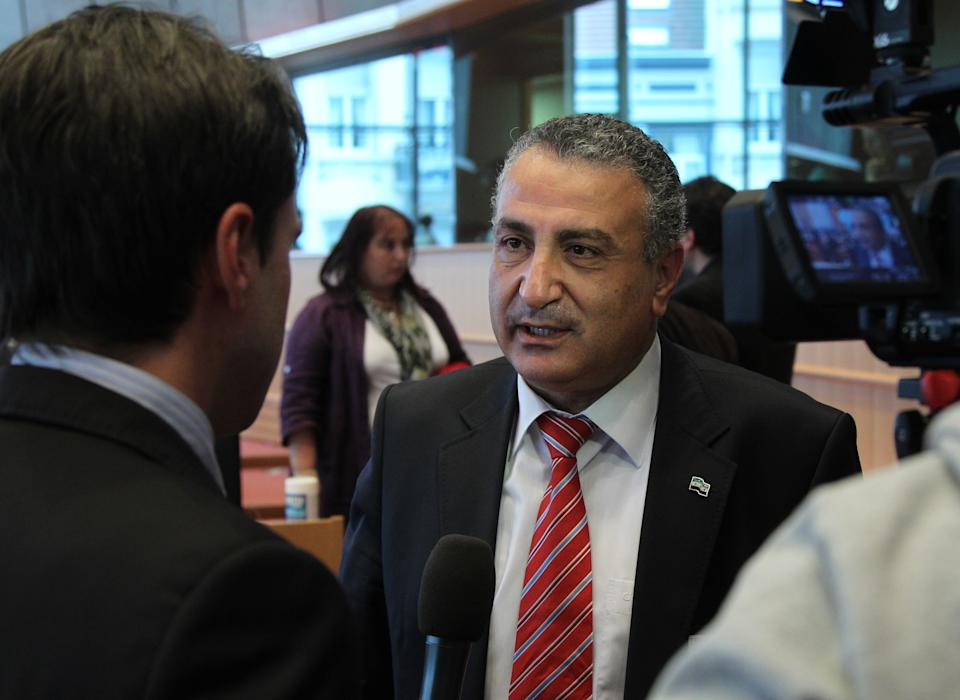 Haitham Al-Maleh, a member of the Syrian opposition, talks to the media as he attends the Committee of Foreign Affairs, at the European Parliament in Brussels, Tuesday, June 19, 2012. (AP Photo/Yves Logghe)
