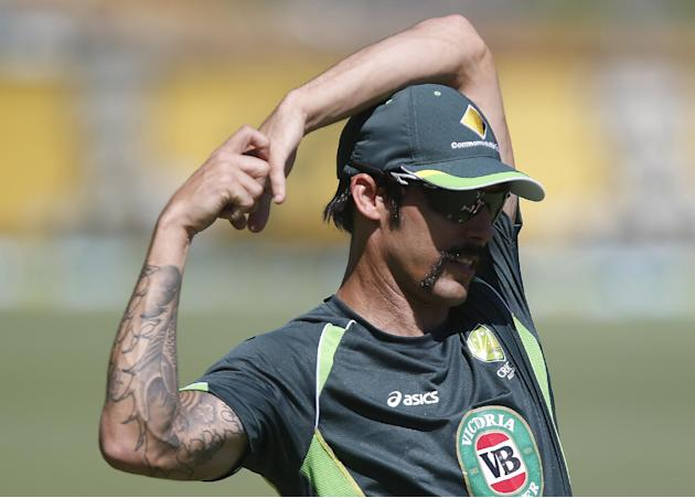 Australia's Mitchell Johnson stretches during a nets session at the WACA in Perth, Australia, Thursday, Dec. 12, 2013. Australia will play against England in the third Ashes test match Friday Dec.