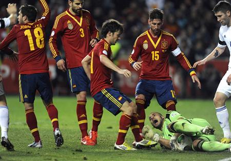 Spain's Jimenez Silva challenges Finland's goalkeeper Maenpaa during their 2014 World Cup qualifying soccer match in Gijon