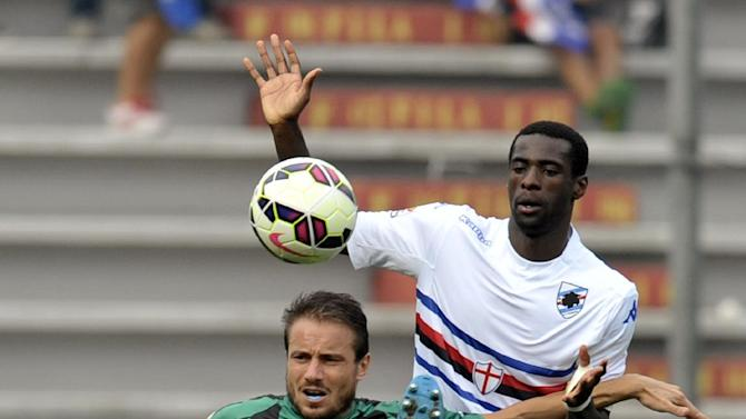 Sassuolo's Matteo Brighi, left, vies for the ball with Sampdoria's Pedro Obiang of Spain, during their Serie A soccer match at Reggio Emilia's Mapei stadium, Italy, Sunday, Sept. 21, 2014