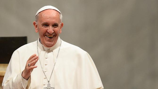 Pope Francis (C) waves to the faithful during a mass in St Peter's Basilica on June 3, 2013 at the Vatican