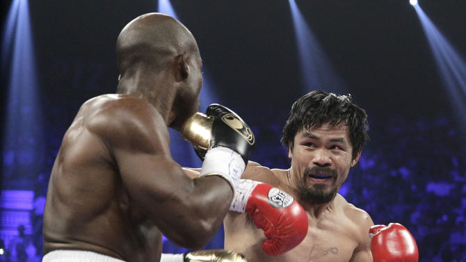 Manny Pacquiao, right, from the Philippines, and Timothy Bradley, from Palm Springs, Calif., work in the first round of their WBO welterweight title fight Saturday, June 9, 2012, in Las Vegas. (AP Photo/Julie Jacobson)