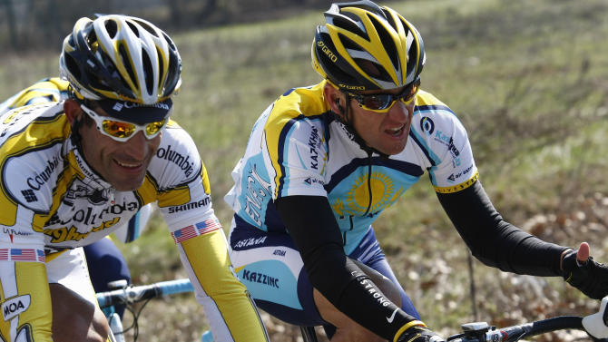 """FILE - This March 21, 2009 file photo shows Lance Armstrong, of the United States, beside fellow countryman George Hincapie, left, during the Milan-San Remo cycling classicin San Remo, Italy. The U.S. Anti-Doping Agency says 11 of Lance Armstrong's former teammates testified against him in its investigation of the cyclist, revealing """"the most sophisticated, professionalized and successful doping program that sport has ever seen."""" (AP Photo/Alessandro Trovati)"""