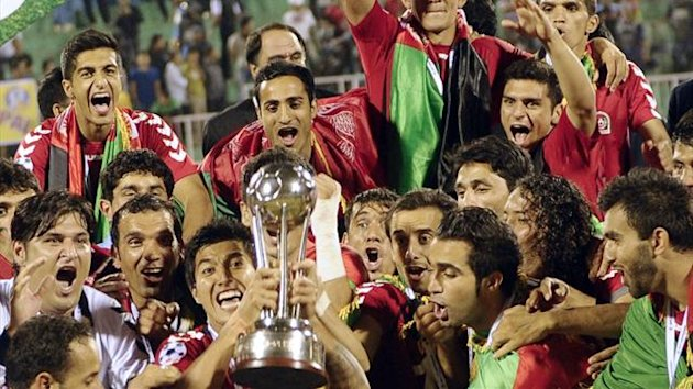 Afghanistan's players celebrate with the trophy, following their victory over India in the SAFF Championship football Cup final match in Kathmandu on September 11, 2013 (AFP)