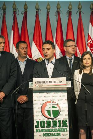 Chairman of the radical nationalist Jobbik party Gabor Vona, center, delivers his speech after the parliamentary elections in the Budapest Congress Centre in Budapest, Hungary, late Sunday, April 6, 2014. (AP Photo/MTI, Janos Marjai)