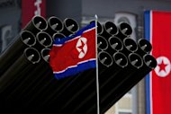 A North Korean flag is seen in front of missiles displayed during a military parade to mark 100 years since the birth of the country's founder Kim Il-Sung, in Pyongyang, in April