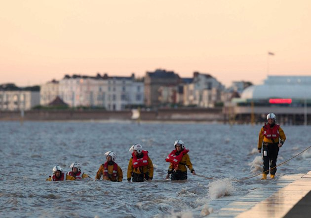 Searching: Members of the RNLI search the waters at Burnham on Sea in Somerset. Little Dylan disappeared after he fell off a slipway 100 metres from the shore at Burnham-on-Sea, Somerset, on Sunday at 6.04pm.