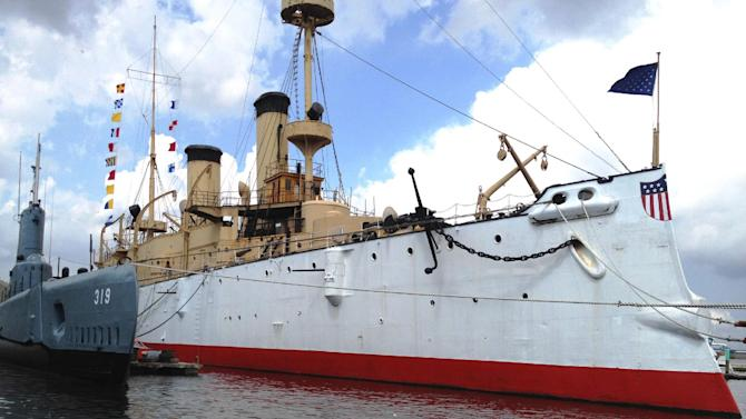 This undated photo provided by the Independence Seaport Museum from August 2012, shows the USS Olympia moored beside the submarine USS Becuna in Philadelphia. The USS Olympia, a one-of-a-kind steel cruiser from the Spanish-American War, has undergone extensive repairs that make it more stable than it has been in years as the field for prospective caretaker has narrowed to groups in San Francisco and South Carolina. (AP Photo/Hope Koseff Corse-Independence Seaport Museum)
