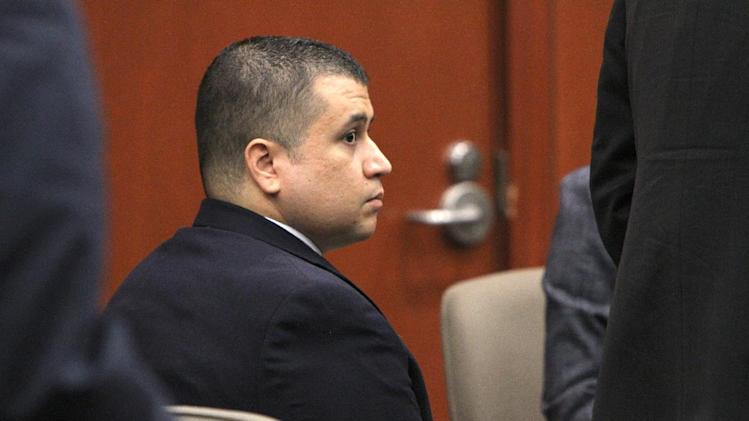"George Zimmerman listens to testimony Friday, Oct. 26, 2012 in Sanford, Fla. The prosecutor in the case of Zimmerman, the former neighborhood watch leader accused of shooting an unarmed teenager, called the conduct of the defense lawyer ""a slippery slope"" in pleading with the judge Friday to impose a gag order on all attorneys. (AP Photo/Orlando Sentinel, George Skene, Pool)"