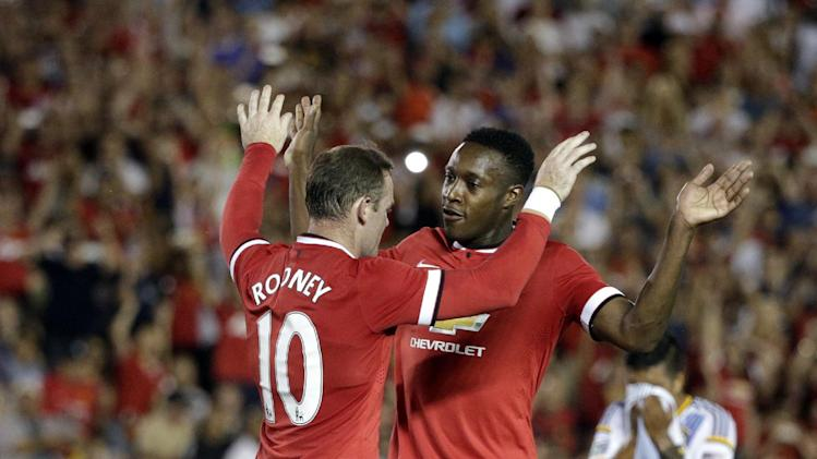 Manchester United's Wayne Rooney, left, celebrates with Danny Welbeck after scoring on a penalty kick during the first half of a friendly soccer match against the Los Angeles Galaxy at Rose Bowl on Wednesday, July 23, 2014, in Pasadena, Calif. (AP Photo)