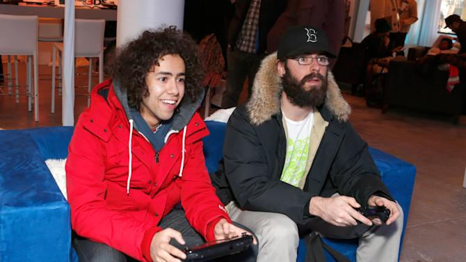 Actors Ramy Youssef, left, and Martin Starr warm up and check out Wii U at the Nintendo Lounge during a break from the Sundance Film Festival on Saturday, January 19, 2013 in Park City, UT. (Photo by Todd Williamson/Invision for Nintendo/AP Images)