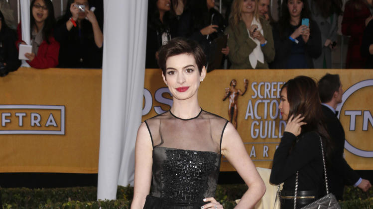 Anne Hathaway arrives at the 19th Annual Screen Actors Guild Awards at the Shrine Auditorium in Los Angeles on Sunday Jan. 27, 2013. (Photo by Todd Williamson/Invision for The Hollywood Reporter/AP Images)