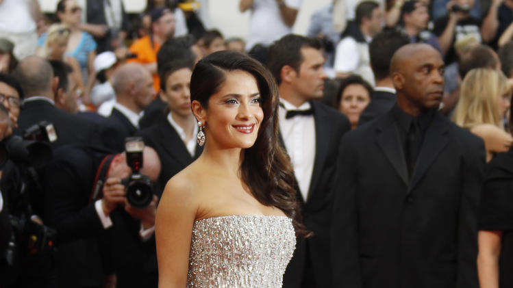 Actress Salma Hayek poses on the red carpet for the screening of Midnight in Paris and the opening ceremony, at the 64th international film festival, in Cannes, southern France, Wednesday, May 11, 2011. (AP Photo/Joel Ryan)