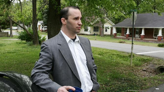 FILE - In this Tuesday April 23, 2013 file photo, Everett Dutschke stands in the street near his home in Tupelo, Miss., and waits for the FBI to arrive and search his home in connection with the sending of poisoned letters to President Barack Obama and others. FBI spokeswoman Deborah Madden says Dutschke, 41, was arrested Saturday, April 27, 2013, at his Tupelo home. U.S. Attorney Felicia C. Adams and Daniel McMullen, the FBI agent in charge in Mississippi, announced later Saturday that Dutschke has been charged with making and possessing ricin in the investigation into poison-laced letters sent to Obama, Sen. Roger Wicker of Mississippi and 80-year-old Mississippi judge Sadie Holland. (AP Photo/Northeast Mississippi Daily Journal, Thomas Wells, File) MANDATORY CREDIT