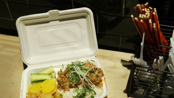 This Monday, Jan. 28, 2013 photo shows the Adobo Chicken Rice Bowl at chef Eddie Huang's Baohaus in New York.  (AP Photo/Seth Wenig)