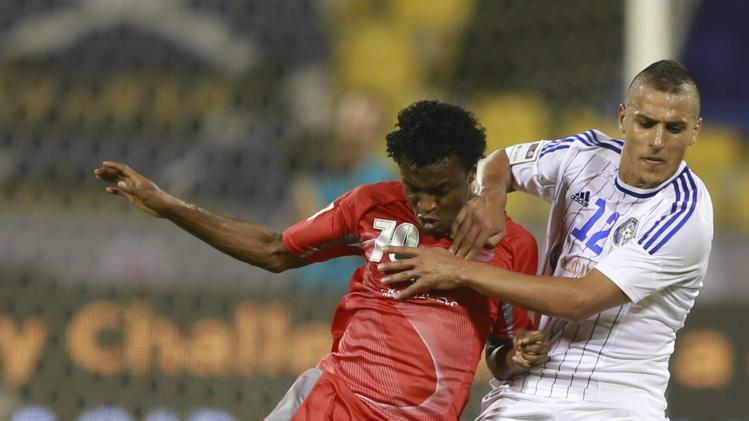 Lekhwiya's Mohammad challenges Al-Sailiya's Ayiesh during their Qatar Cup semi-final soccer match in Doha
